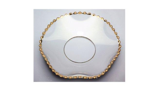 På billedet ser du variationen Lysmanchet. Med guld kant. Bølgeformet glas fra brandet i en størrelse D: 7 cm. i farven Guld